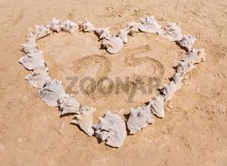 Karko shells in heart shape on beach