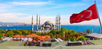 Blue Mosque in front of the Bosphorus and the turkish flag, Istanbul, Turkey panorama