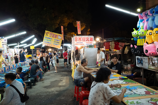 night marketplace with vendor and people shop