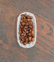 Coffee beans in a white bowl for food photography