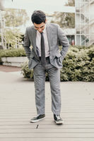Confident and successful young businessman posing outdoor. Business and people.