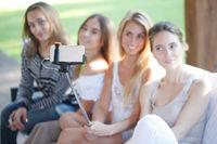 Female friends taking selfie