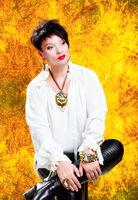 Portrait of a beautiful glamorous woman. Yellow background.