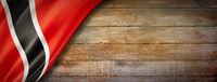 Trinidad And Tobago flag on vintage wood wall banner
