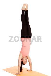 Yoga exercise on the mat, adho mukha vrikshasana