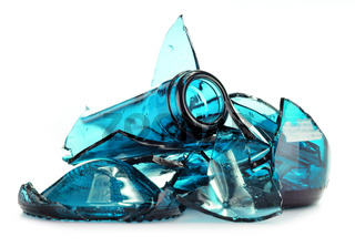 Pieces of broken glass over white background. Recycling.