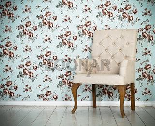 One classic armchair against a wall and floor