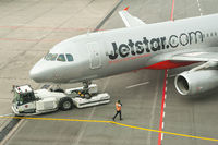 Singapore, A Jetstar Airways Airbus A320 passenger plane during pushback at Changi Airport