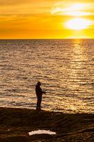 Fisherman during sunset in Sardinia