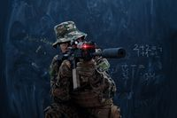 soldier in action aiming laseer sight optics