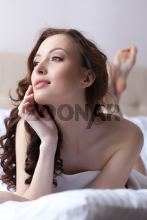 Portrait of charming young woman with healthy skin