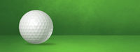 White golf ball on a green studio banner