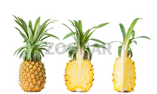 Fresh whole and sliced ripe pineapple isolated on white background