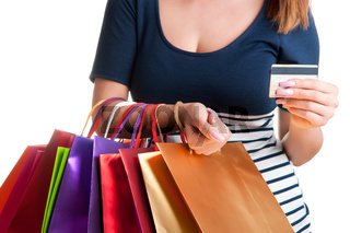 Woman Carrying Shopping Bags And Holding a Credit Card