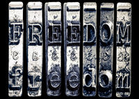 the word FREEDOME with old typewriter hammers