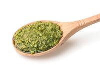Wooden spoon of pesto sauce