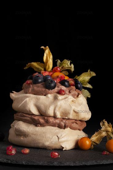 Pavlova cake with mix fruit.