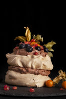Pavlova cake with mix fruit.