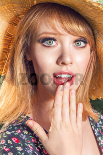 Portraits of a beautiful red-haired girl with a cute face.  Woman have a wonderful mood and a lovely smile