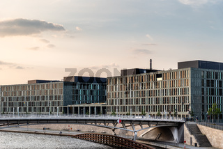 Panoramic view of modern office buildings on the banks of the Spree River in Berlin during sunset