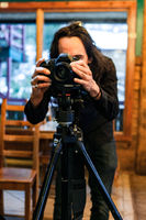 Behind the camera lens of a photographer