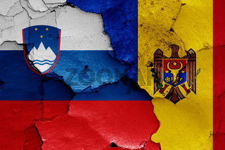 flags of Slovenia and Moldova painted on cracked wall