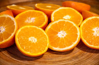 Bunch of fresh sliced oranges on a tray