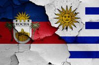 flags of Rocha Department and Uruguay painted on cracked wall