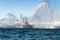 Rescue ship spraying water on sea for supporting emergency case of fire