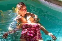 Senior woman receiving water massage in pool
