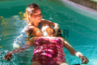 Senior woman receiving water massage in pool