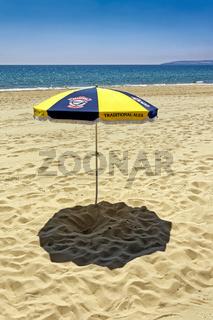 A Sun Umbrella on Bournemouth Beach, Dorset, England, UK
