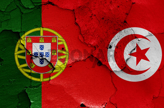 flags of Portugal and Tunisia painted on cracked wall