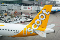 Singapore, A Scoot Airways passenger plane is parked at a gate at Changi Airport