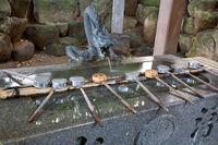 Dragon statue over purification fountain in Yaotomi Shrine on Take Island, Japan