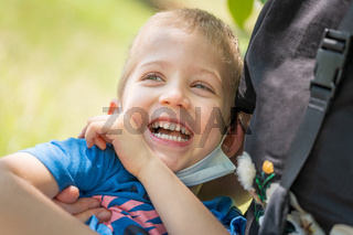 Close up portrait of cute little son hug cuddle laughing enjoying