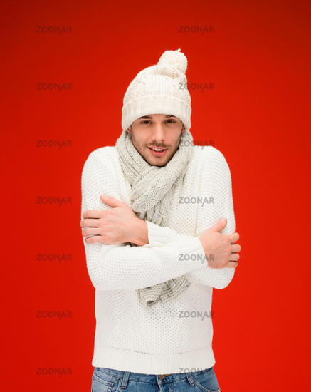 man in warm sweater, hat and scarf