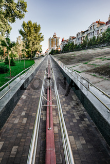 Long metal ramp for handicapped people, bicycles and people with strollers