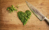 Cutting board with parsley cut in a heart shape