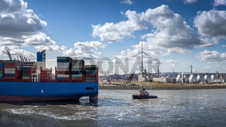 End of a container ship on the hook of a tug