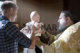 Belarus, Gomel, September 17, 2018. Prudkovsky church. The baptism of the child.Orthodox priest conducts the rite of baptism of the child. Acceptance of faith.