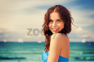happy smiling woman on the beach