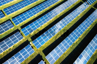 Aerial view of solar panels on a sunny day. power farm producing clean energy.
