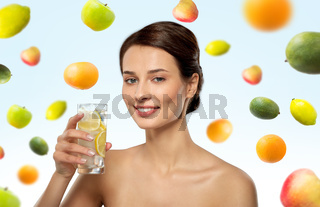 woman drinking water with lemon and ice