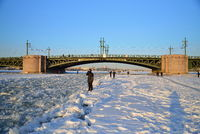 People take pictures of the sun on the ice of the Neva river at