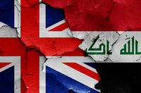 flags of UK and Iraq painted on cracked wall