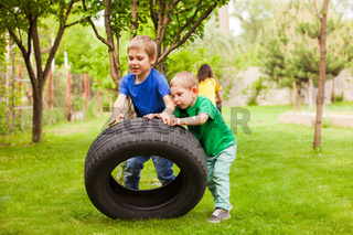 The little boys develop physical strength using improvised things