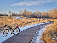 touring bicycle on a trail in late fall or winter scenery