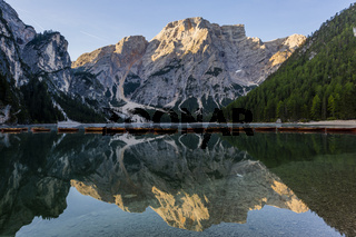 Beautiful reflection of Seekofel mountain in Lake Braies at sunrise, Italy