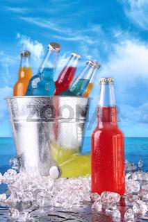 Summer drinks in ice bucket on the beach